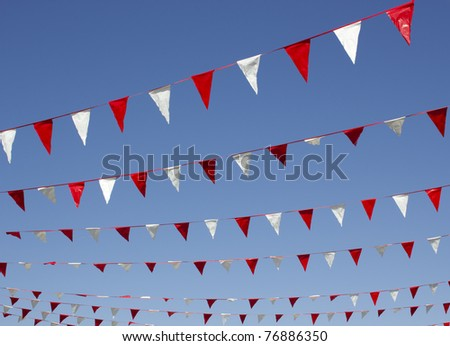 Small bunting hanging above a shopping mall - stock photo