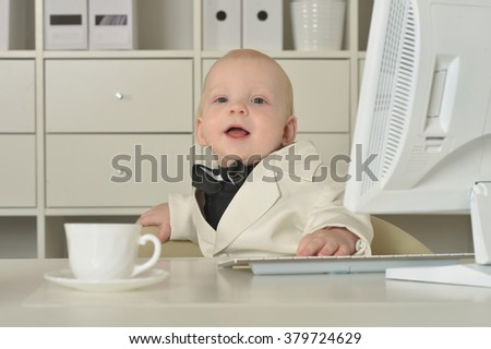 Small  business boy and computer