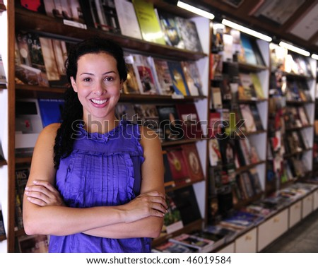 small business: happy owner of a bookstore - stock photo