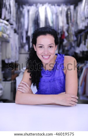 small business: happy owner of a dry cleaner store - stock photo