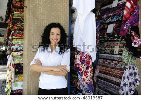 small business: happy owner of a fabric store - stock photo