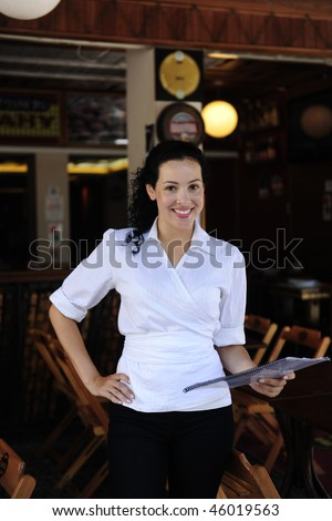 small business: happy owner of a restaurant - stock photo