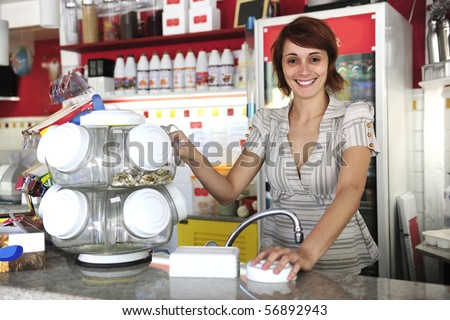 small business: happy waitress selling candy - stock photo
