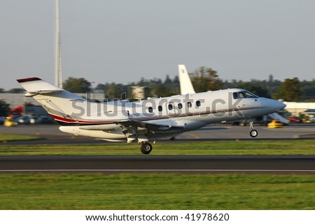 small business jet taking off from the runway - stock photo