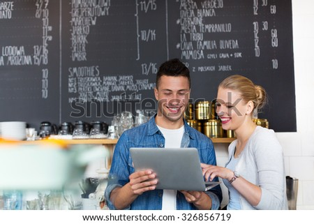 Small business owner in coffee shop  - stock photo