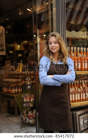small business owner in front of store - stock photo