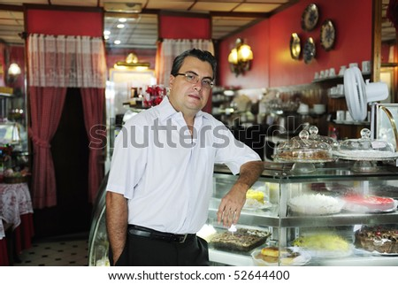small business: owner of a cafe - stock photo