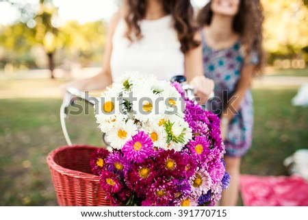 Small business owners. Two best friends selling flowers outdoors. Selective focus, depth of field   - stock photo
