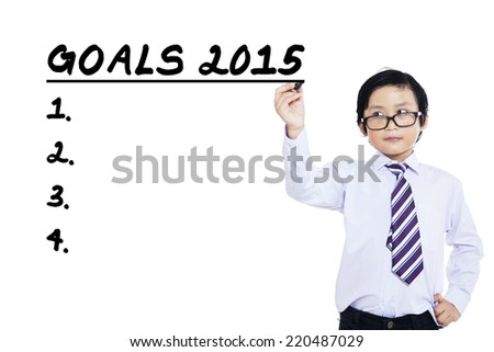 Small business person writes business goals in 2015, isolated over white background - stock photo