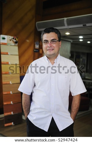 small business: portait of a proud and confident retail floor store owner - stock photo