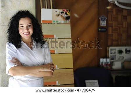 small business: portait of a proud floor store owner - stock photo