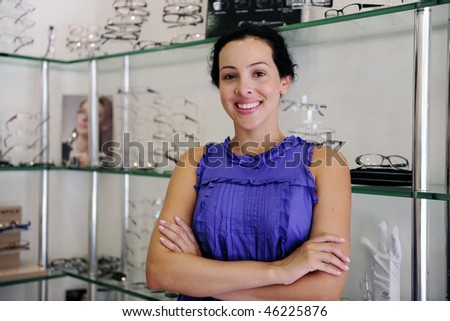 small business: portrait of an optometrist inside her store - stock photo