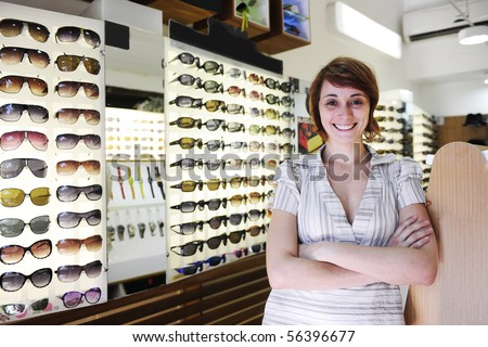 small business: portrait of the  owner of a sunglasses store - stock photo