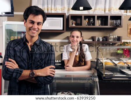small business portrait: owner of a cafe and waitress - stock photo