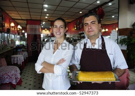 small business: proud female owner of a cafe and waiter - stock photo