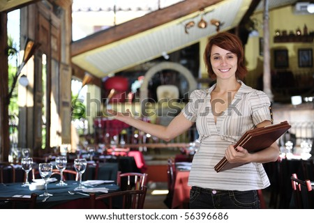 small business: proud female owner of a restaurant with copy space - stock photo