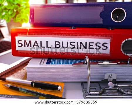 Small Business - Red Office Folder on Background of Working Table with Stationery and Laptop. Small Business Business Concept on Blurred Background. Small Business Toned Image. 3D. - stock photo