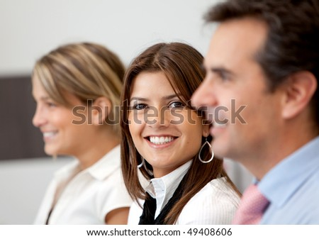 Small business team at the office smiling - stock photo
