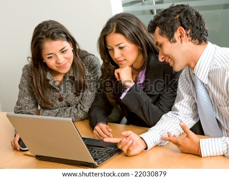 small business team in a meeting on a laptop computer in an office