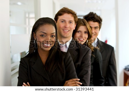 Small business team in an office smiling