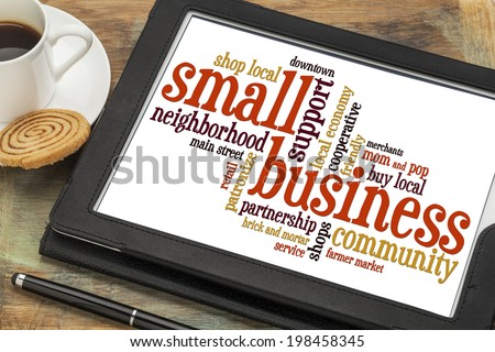 small business word cloud on a digital tablet with a cup of coffee - stock photo