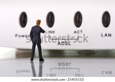 small businessman examining the internet speed (selective focus) - stock photo