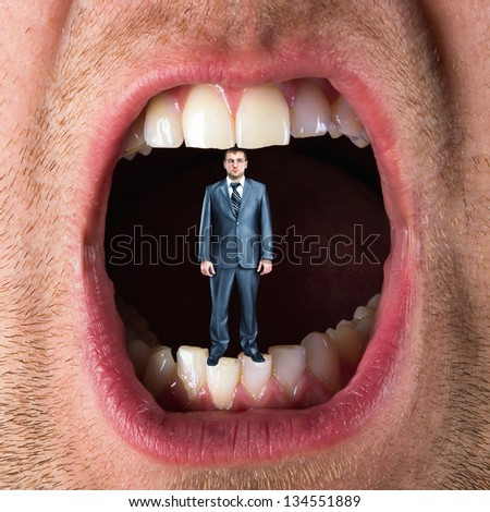 Small businessman standing in open mouth - stock photo