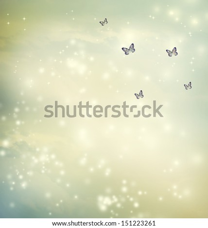 Small butterflies in a fantasy sky - stock photo