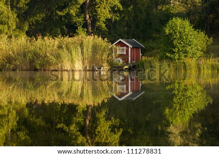 Small cabin on the coast of a lake, Sweden