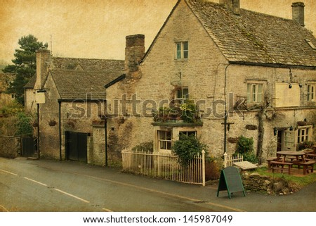 small cafe in Bibury, Gloucestershire, England.  Photo in retro style. Paper texture. - stock photo