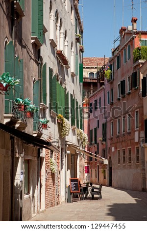 Small cafe on street in Venice, Italy - stock photo