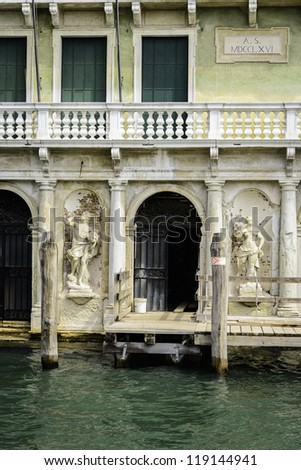 Small Canal among houses in Venice, Italy - stock photo