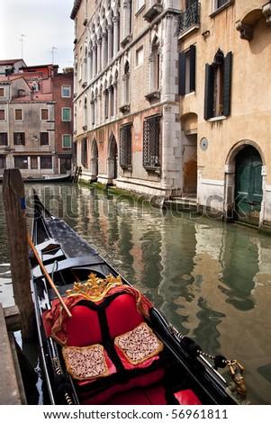 Small Canal Bridge Buildings Gondola Boats Reflections Venice Italy - stock photo