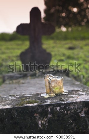 Small candle in an old, abandoned cemetery, Hungary - stock photo