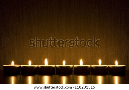 Small candles in row with space for text. Holiday/ romance/ religion/ meditation concept - stock photo