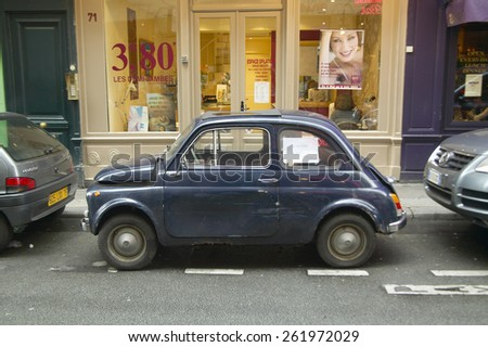 Small car parked on street, Paris, France - stock photo