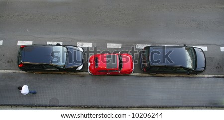 Small car uses little space for parking. Concepts like clever, small cars, parking troubles or abstracts like the smaller the better. - stock photo