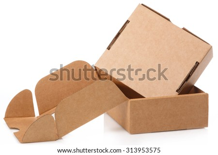 Small cardboard boxes on white background - stock photo