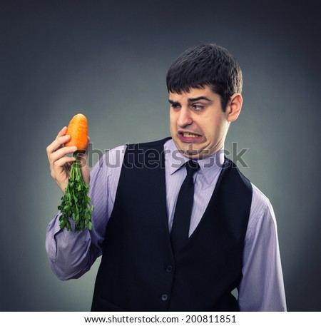 Small carrot in hands - stock photo