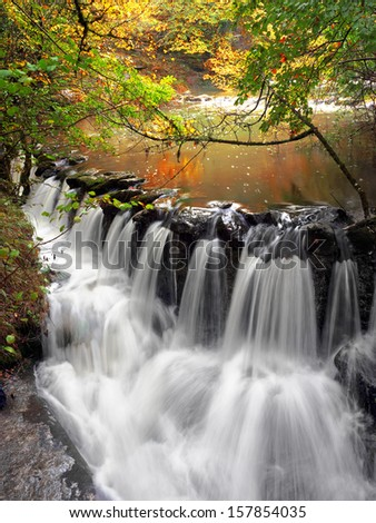 small cascade in water stream - stock photo