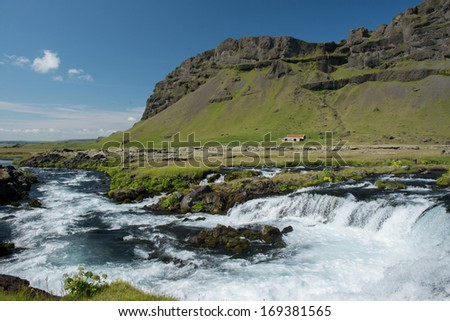 Small Cascading Waterfall at the South Coast of Iceland - stock photo