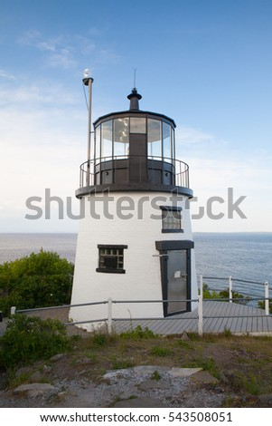 Small Castle Hill lighthouse in Newport, Rhode Island overlooking the Atlantic Ocean, built in 1830