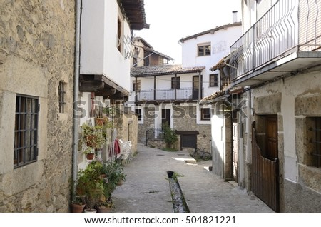 Small channel with clear water collected from the snowfields of the mountain at the floor of the street in  Candelario,  a village of the province of Salamanca, Spain.