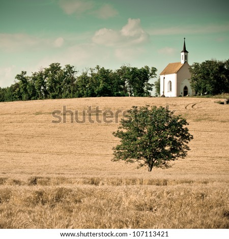 Small chapel with a meadow -colorized photo