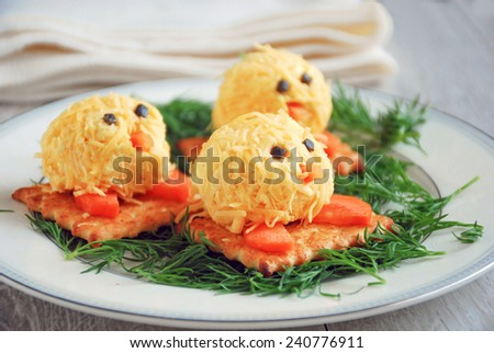 Small cheese balls shaped as little chickens, fun party food for kids - stock photo