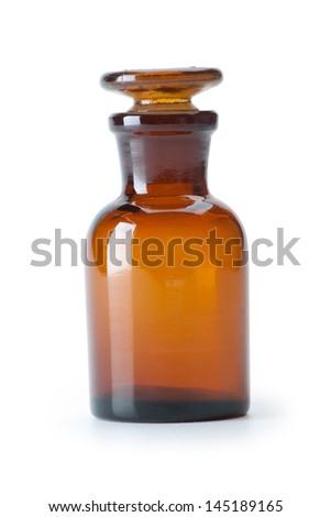 Small chemical glass bottle on white background - stock photo