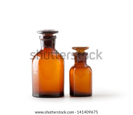 Small chemical glass bottles on white background - stock photo