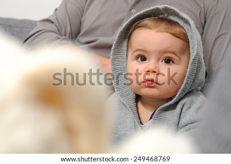 Small child - Baby sitting on sofa - stock photo