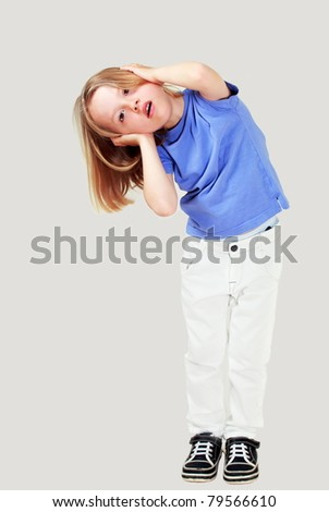 Small child covering ears maybe against noise - stock photo