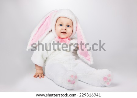 small child in a white bunny costume - stock photo